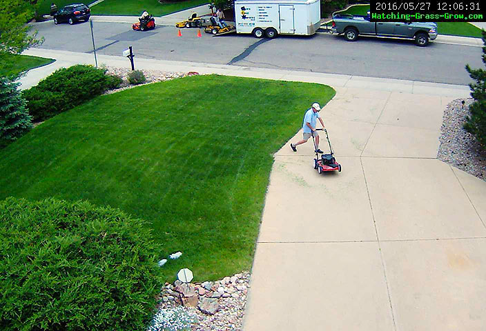 mowing grass with commercial lawn service